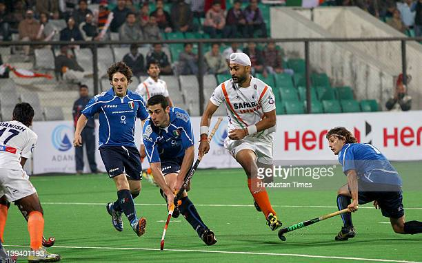 Indian Hockey player Sandeep Singh in action against Italy during a FIH London 2012 Olympic Hockey Qualifying Tournament at Major Dhyan Chand Stadium...
