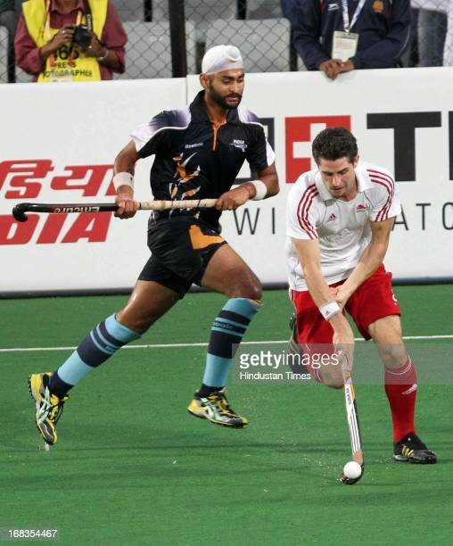 Indian Hockey Player Sandeep Singh vying for ball with England player during the Mens semi final match between India and England of Commonwealth...