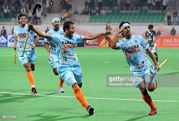 Indian hockey player Shivendra Singh celebrates a goal against Pakistan with teammates during their hockey World Cup 2010 match at the Major Dhyan...