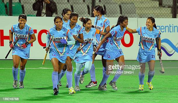 Indian hockey players celebrate a goal against Ukraine during the women's hockey match between India and Ukraine of the FIH London 2012 Olympic...