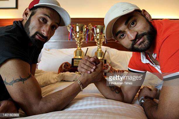 Indian Hockey players Sandeep Singh and Sardar Singh pose for portraits after securing India's place at London Olympics on February 28 2012 in New...