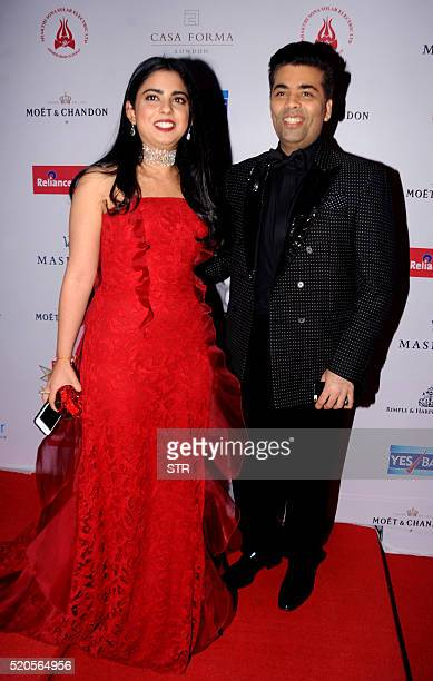 Indian Hollywood film producer and director Karan Joharposes with Isha Ambani as they attend the Hello Hall of Fame Awards 2016 in Mumbai late April...