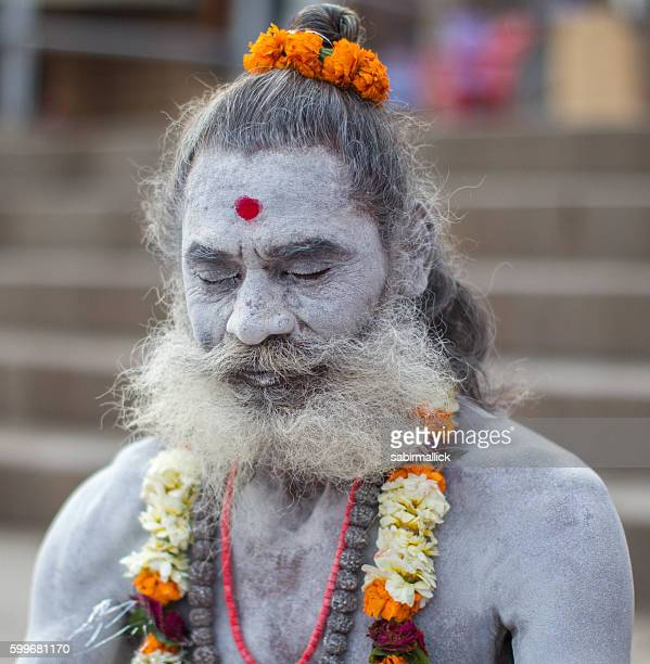 Indian Holy man meditating at Varanasi, India.