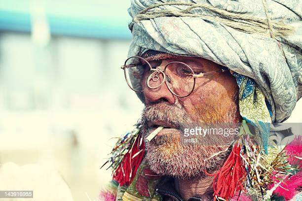 Indian holy man smoking at Pushkar Camel Fair