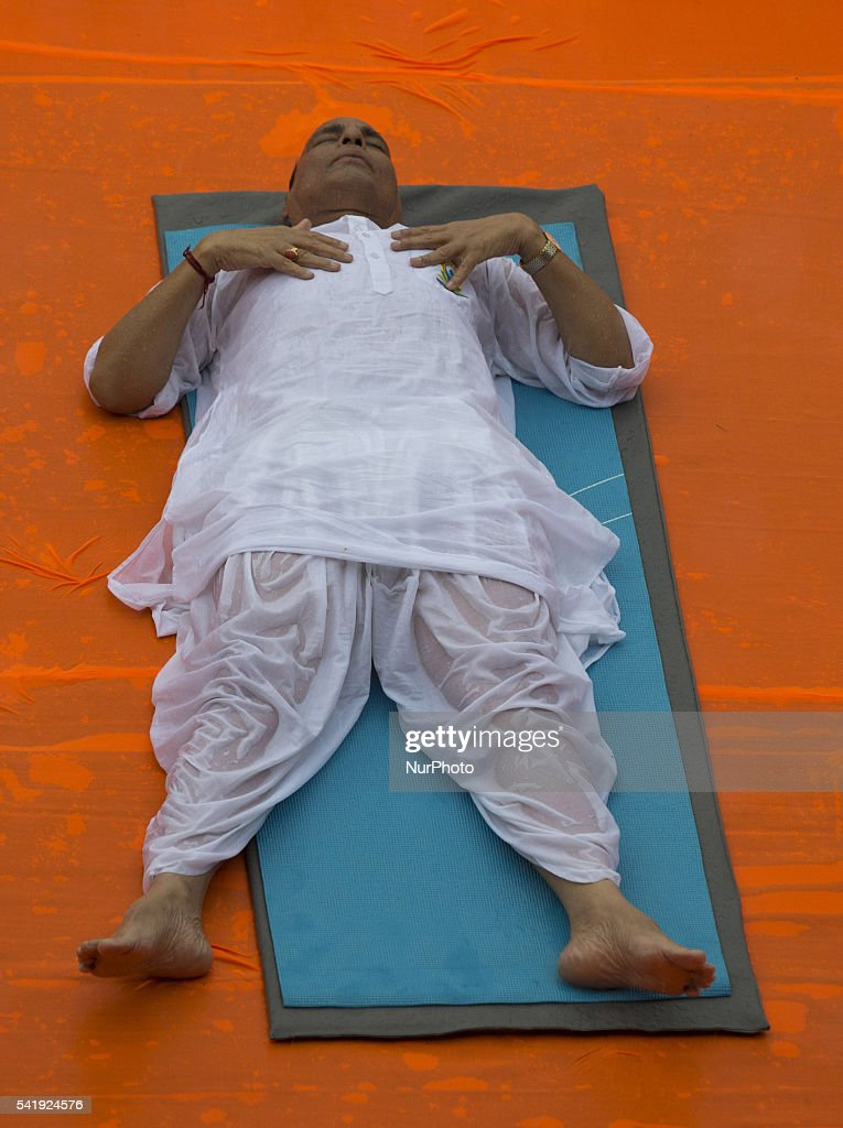Indian Home Minister mr. <a gi-track='captionPersonalityLinkClicked' href=/galleries/search?phrase=Rajnath+Singh&family=editorial&specificpeople=582959 ng-click='$event.stopPropagation()'>Rajnath Singh</a> participates in a mass yoga session , to mark International Yoga Day,during heavy rains at K. D. Singh Babu stadium ,Lucknow on June 21,2016.
