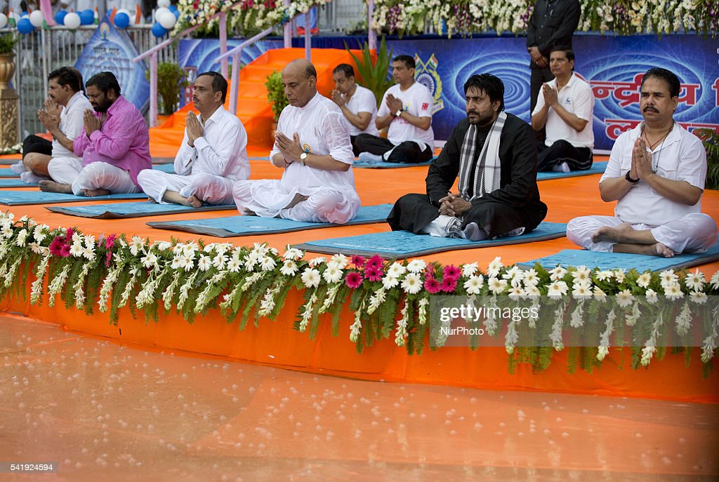 Indian Home Minister mr. Rajnath Singh(C) participates in a mass yoga session , to mark International Yoga Day,during heavy rains at K. D. Singh Babu stadium ,Lucknow on June 21,2016.