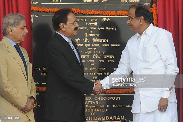 Indian Home Minister P Chidambaram shakes hands with Pakistan Commerce Minister Makhdoom Amin Fahim while Pakistani Punjab state Chief Minister...