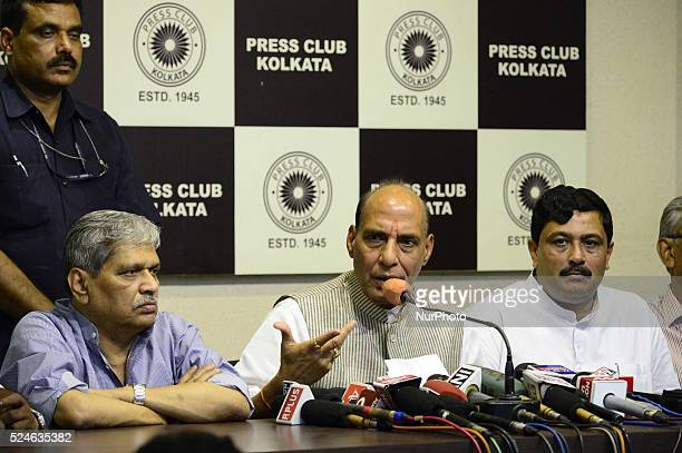 Indian Home Minister Rajanath Singh gestures as he addresses a press conference and present BJP state President Rahul Sinha Pravat Jha in Kolkata on...