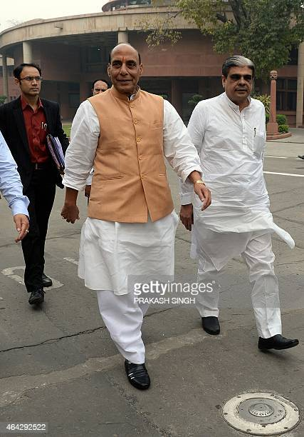 Indian Home Minister Rajnath Singh walks with party officials after a Bharatiya Janata Party Parliamentary Board meeting at Parliament House in New...