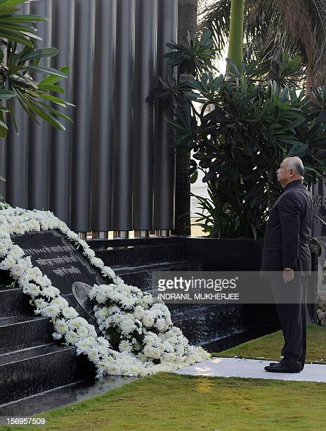 Indian Home Minister Sushil Kumar Shinde lays a wreath at a memorial for those police and uniformed personnel who lost their lives in 2008 terror...