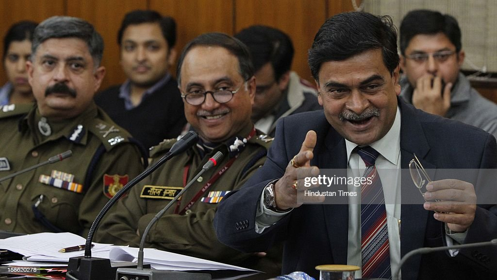 Indian Home Secretary R K Singh (R) and Delhi Police Commissioner Neeraj Kumar (C) addressing the media on recent rape case, at Home Ministry on December 21, 2012 in New Delhi, India. The parliament standing committee on Home affairs has issued the summons to Home secretary RK Singh and Delhi police commissioner Neeraj Kumar on the security of women in country in the wake of recent gang rape case in Delhi.