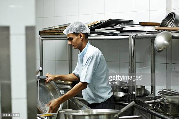 Indian hotel staff washing dirty dishes