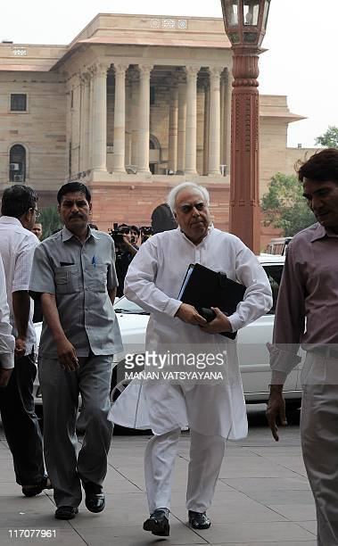 Indian Human Resource Development minister Kapil Sibal arrives for a meeting at the Finance Ministry in New Delhi on June 21 2011 The joint drafting...