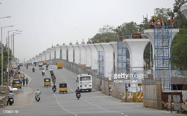 Indian Hyderabad Metro Rail project labourers work at a construction site in Hyderabad on June 15 2013 Works related to Hyderabad Metro Rail are...