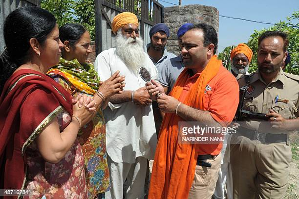 Indian independent candidate for Amritsar's parliamentary seat Amarinder Singh gestures during election campaigning at a village in Chogawan about 25...