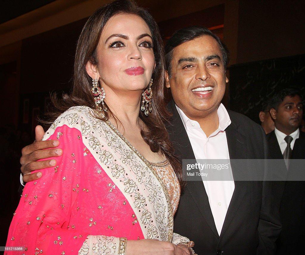 Indian industralist Mukesh Ambani and his wife Nita Ambani during Shabana Azmi's charity fundraising fashion show Mijwan at Grand Hyatt in Mumbai on September 3, 2012.