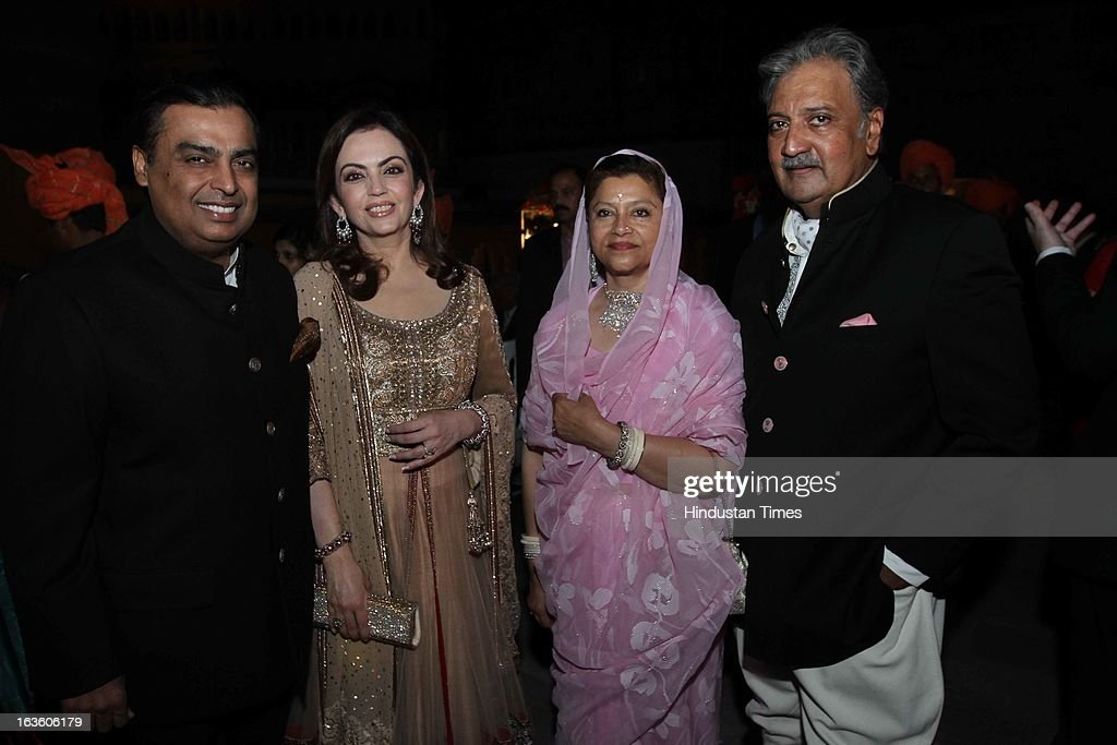 Indian industralist Mukesh Ambani and his wife Nita Ambani with host his highness Gaj Singh II and his wife Hemlata Rajye at the party at the Mehrangarh Fort on March 8, 2013 in Jodhpur, India.