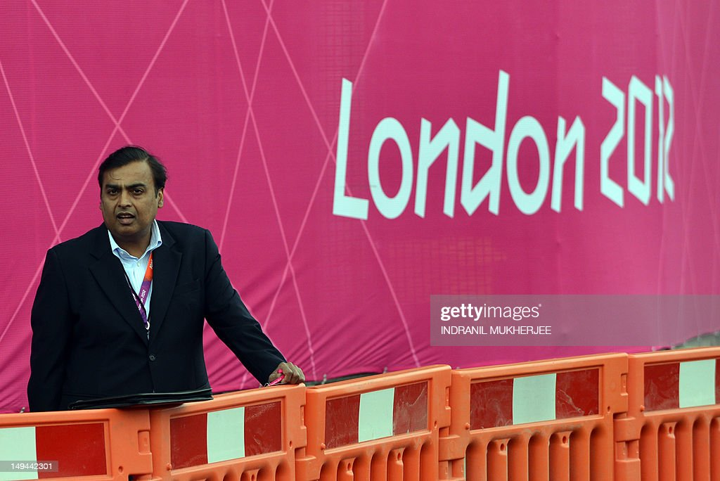 Indian industrialist and Chairman of Reliance Industries Limited Mukesh Ambani stands near The Riverbank Arena in London on July 28, 2012, on the first day of the London 2012 Olympic Games.