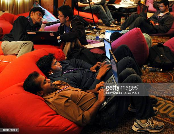 Indian Information Technology professionals work on their laptops during an 'Open Hack Day' programme organised by the global search engine Yahoo in...