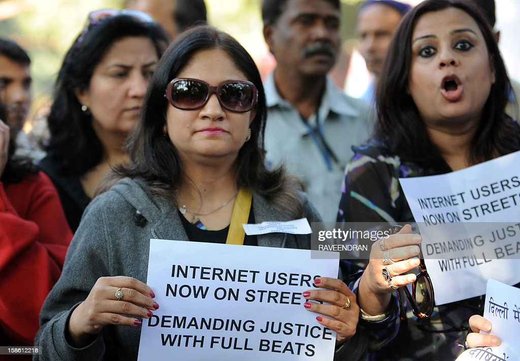 Indian Internet and facebook users shout anti-government slogans as they hold placards during a protest in New Delhi on December 21, 2012, following the gang-rape of a student in the Indian capital. Indian police have arrested the driver and four others of a bus after a student was gang-raped and thrown out of the vehicle, reports said, in an attack that has sparked fresh concern for women's safety in New Delhi. The attack sparked new calls for greater security for women in New Delhi, which registered 568 rapes in 2011 compared with 218 in India's financial capital Mumbai the same year.