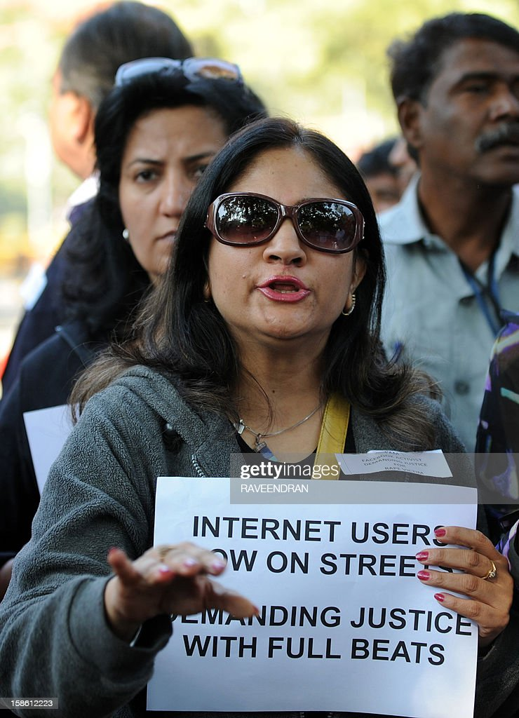 Indian Internet and facebook users shout anti-government slogans as they hold placards during a protest in New Delhi on December 21, 2012, following the gang-rape of a student in the Indian capital. Indian police have arrested the driver and four others of a bus after a student was gang-raped and thrown out of the vehicle, reports said, in an attack that has sparked fresh concern for women's safety in New Delhi. The attack sparked new calls for greater security for women in New Delhi, which registered 568 rapes in 2011 compared with 218 in India's financial capital Mumbai the same year. AFP PHOTO/RAVEENDRAN