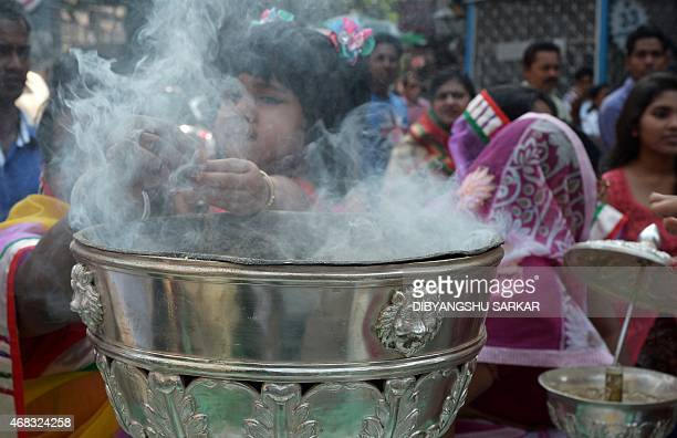 Indian Jain devotees perform rituals as they participate in a religious rally organised on the occasion of Mahavir Jayanti in Kolkata on April 2 2015...