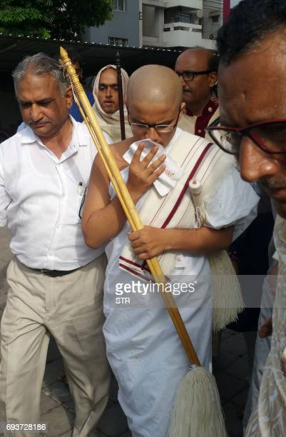 Indian Jain monk Varshil Shah leaves after taking part in a ritual to become a Jain disciple in Surat some 270 kms from Ahmedabad on June 8 2017 An...