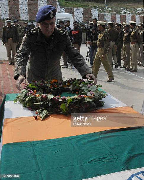 Indian Jammu and Kashmir Inspector General of Police Abdul Gani Mir lays a wreath over the coffins of two Indian Central Reserve Police Force...