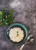 Indian cumin jeera cashew pulao rice. served in rustic bowl on tray.  Top view, blank space