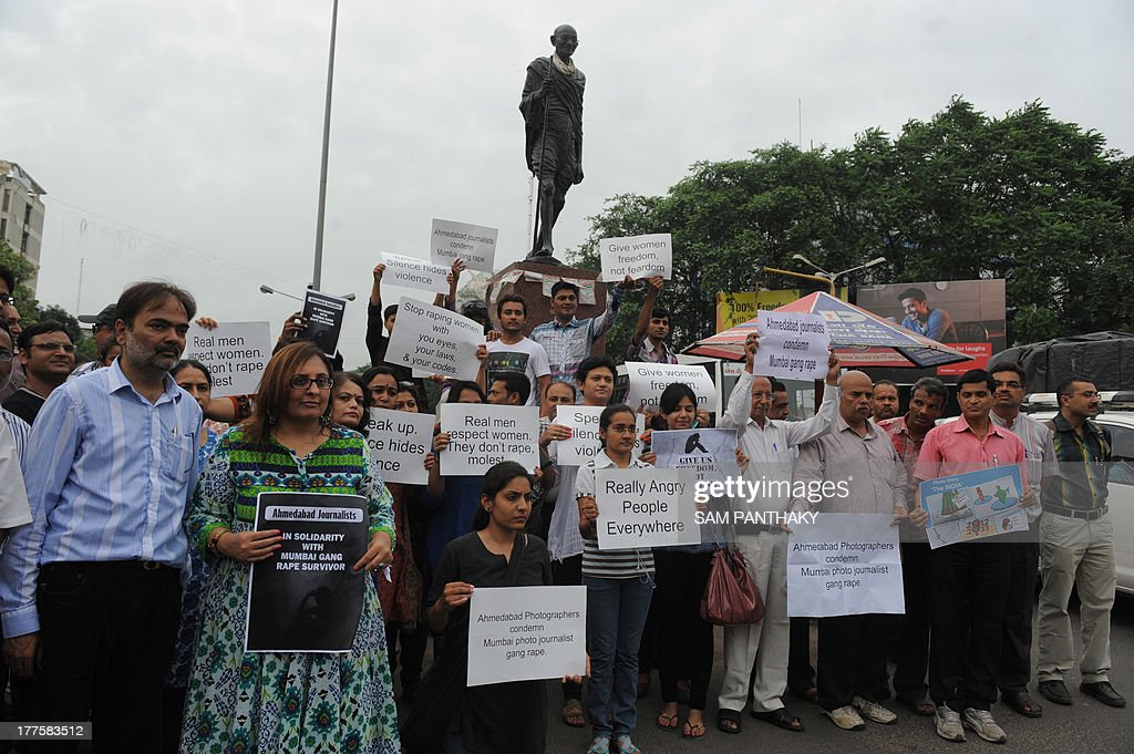 Indian journalists stage a protest against the gang-rape of a female colleague in Mumbai, at the Mahatma Gandhi Ashram in Ahmedabad on August 24, 2013. Mumbai police arrested a second man on accusations of gang-raping a female photographer in the Indian financial hub - an attack that has renewed anger over the country's treatment of women. AFP PHOTO/ Sam PANTHAKY