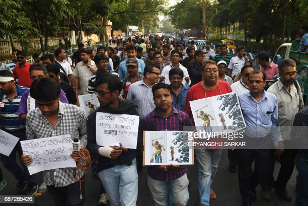 Indian journalists take part in a protest after media personnel were injured covering clashes between police and demonstrators in Kolkata on May 23...