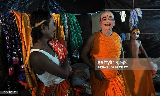 Indian junior artists joke with Laxmi Narayan Jha affectionately known as 'Grandpa' as they prepare for a show backstage at the Maharashtra Ramlila...