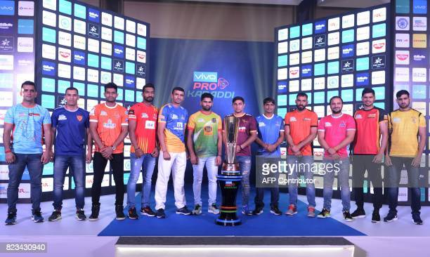Indian Kabaddi eam captains pose with the trophy of the fifth edition Pro Kabaddi League 2017 in Hyderabad on July 27 2017 The fifth edition of the...