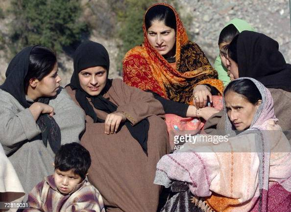 Indian Kashmiri earthquake victims listen to a speech by India's Western Air Command Commander in Chief A K Singh at Uroosa in Uri sector some 117 km...