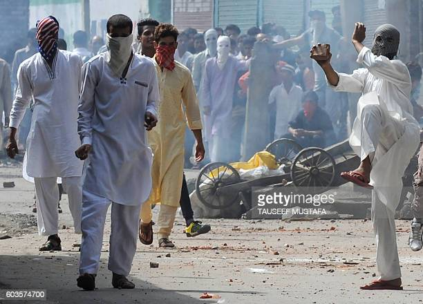 Indian Kashmiri protesters clash with Indian government forces during the Muslim festival of EidulAdha during a curfew in Srinagar on September 13...