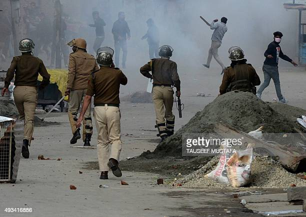 Indian Kashmiri protesters clash with Indian police during a protest in Srinagar on October 20 2015 Protests erupted after chairman of Jammu Kashmir...