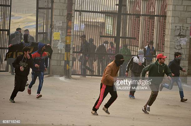 Indian Kashmiri protestors clash with Indian government forces after Friday prayers in downtown Srinagar on December 9 2016 More than 90 civilians...