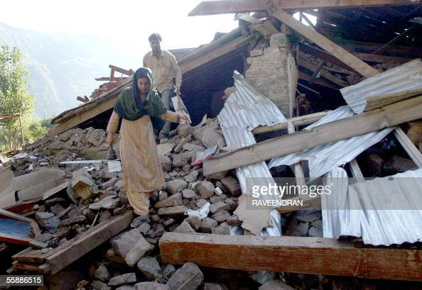Indian Kashmiri residents search through the wreckage of their homes which were destroyed by a 76 magnitude earthquake two days before in Uri some...