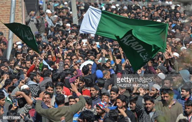 Indian Kashmiri villagers shout proindependence slogans as they carry a body of a youth Umar Farooq at his funeral in Baroosa in central Kashmirs...