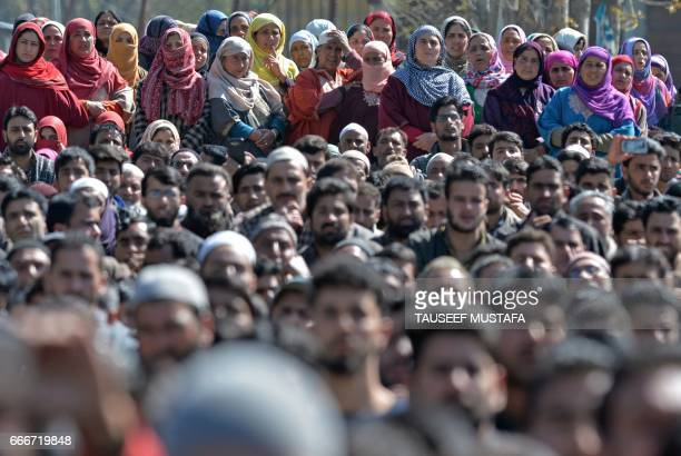 Indian Kashmiri villagers watch the funeral for youth Umar Farooq in Baroosa in central Kashmirs Ganderbal district on April 10 2017 Eight civilians...