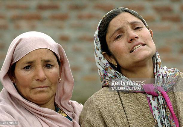 Indian Kashmiri woman Tasleem watches as forensic experts exhume the body of his husband Nazir Ahmed Deka killed during an alleged fake gunbattle at...