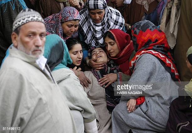 Indian Kashmiri women cry during a funeral for civilian Abdul Gani in Gundipora village in Pulwama district south of Srinagar on February 21 2016...