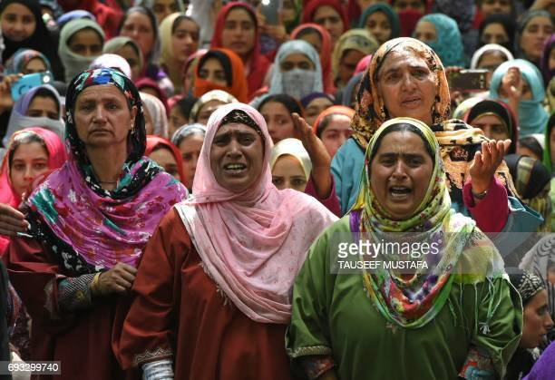 Indian Kashmiri women mourn during the funeral of college student Adil Farooq Magray at Ganawpora village in Shopian district south of Srinagar on...