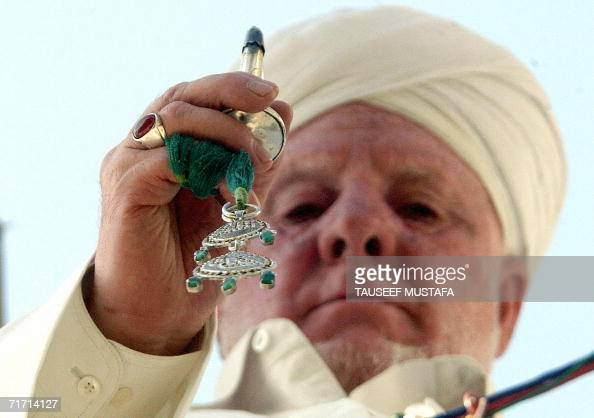 Indian Kashmir's chief priest holds a holy relic believed to be a hair from the Prophet Mohammed's beard at the Hazratbal Shrine on the outskirts of...