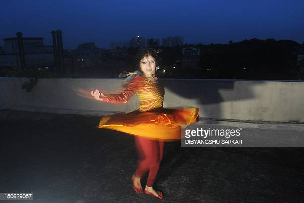 Indian Kathak dancer Chirasree Dasgupta performs during a demonstration to photographers following her world record in Kathak dance spinning in...