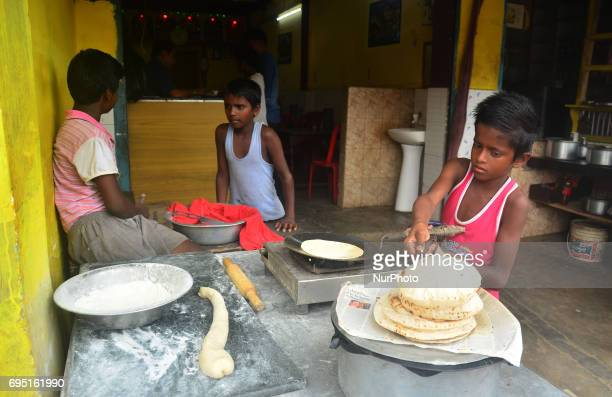 Indian kids baked Roti at a roadside hotel on World Day Against Child Labour in Dimapur India northeastern state of Nagaland on Monday June 12 2017...