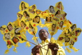Indian kitemaker Jagmohan Kanojia poses with kites adorned with images of Bollywood actresses on the eve of Valentine's Day and Basant Panchami in...