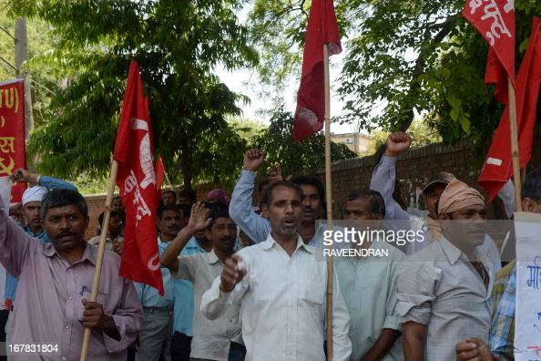 Indian labour and trade union activists from leftist parties shout antigovernment slogans as they march during a May Day rally in New Delhi on May 1...