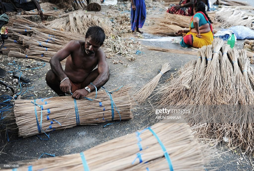 Indian labourer Krishnan, 41, bundles finished coconut leaves used to make broom sticks at a production unit in Chennai on May 31, 2016. India's economy grew 7.6 percent in 2015-16, official figures showed May 31, retaining its place as the world's fastest-growing major economy and providing a boost to the right-wing government as it marks two years in power. Gross domestic product (GDP) expanded at a faster pace in the fourth quarter of the financial year, growing 7.9 percent year-on-year, the Central Statistics Office data showed. SANKAR