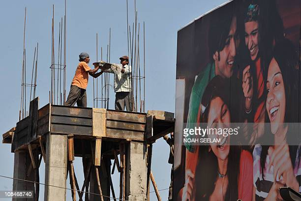 Indian labourers work at a construction site in Hyderabad on January 28 2011 The International Labour Organisation warned January 24 that the global...